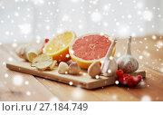 Купить «citrus, ginger, garlic and rowanberry on wood», фото № 27184749, снято 13 октября 2016 г. (c) Syda Productions / Фотобанк Лори