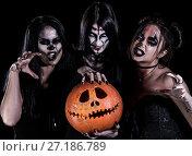 Купить «Three women with Halloween makeup», фото № 27186789, снято 28 октября 2017 г. (c) Art Konovalov / Фотобанк Лори