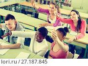 Купить «Group of happy school pupils raise their hands up», фото № 27187845, снято 14 декабря 2017 г. (c) Яков Филимонов / Фотобанк Лори