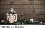 Купить «Christmas decorations on dark old wooden background», фото № 27188557, снято 18 октября 2017 г. (c) Майя Крученкова / Фотобанк Лори