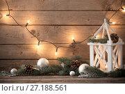 Купить «Christmas decorations on dark old wooden background», фото № 27188561, снято 18 октября 2017 г. (c) Майя Крученкова / Фотобанк Лори