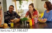 Купить «Executives interacting while having lunch at table 4k», видеоролик № 27190637, снято 24 января 2020 г. (c) Wavebreak Media / Фотобанк Лори