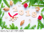 Купить «New Year 2018 background with 2018 figures,Christmas toys, fir branches - New Year 2018 composition», фото № 27191005, снято 30 ноября 2016 г. (c) Зезелина Марина / Фотобанк Лори