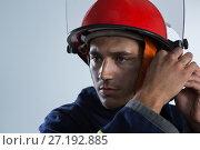 Купить «Fireman adjusting his safety helmet», фото № 27192885, снято 25 августа 2017 г. (c) Wavebreak Media / Фотобанк Лори