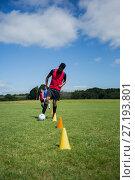 Купить «Soccer player dribbling through cones», фото № 27193801, снято 26 июля 2017 г. (c) Wavebreak Media / Фотобанк Лори
