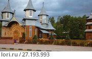 Купить «Wooden orthodox church Saints Peter and Paul, Carlibaba village, Romania», видеоролик № 27193993, снято 7 октября 2017 г. (c) Яков Филимонов / Фотобанк Лори