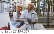 Купить «Traveling mature spouses resting on stone bench on city street, looking map», видеоролик № 27194057, снято 11 сентября 2017 г. (c) Яков Филимонов / Фотобанк Лори