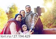 Купить «family with backpacks taking selfie and hiking», фото № 27194429, снято 27 сентября 2015 г. (c) Syda Productions / Фотобанк Лори