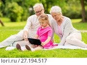 Купить «grandparents and granddaughter with tablet pc», фото № 27194517, снято 9 августа 2017 г. (c) Syda Productions / Фотобанк Лори