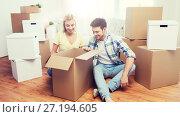 Купить «smiling couple with big boxes moving to new home», фото № 27194605, снято 25 февраля 2016 г. (c) Syda Productions / Фотобанк Лори