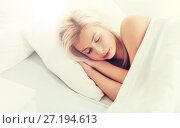 Купить «young woman sleeping in bed at home bedroom», фото № 27194613, снято 25 февраля 2016 г. (c) Syda Productions / Фотобанк Лори