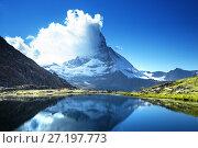 Купить «Reflection of Matterhorn in lake Riffelsee, Zermatt, Switzerland», фото № 27197773, снято 11 сентября 2017 г. (c) Iakov Kalinin / Фотобанк Лори