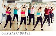 Купить «Group of energetic people of different ages dancing», фото № 27198193, снято 9 октября 2017 г. (c) Яков Филимонов / Фотобанк Лори