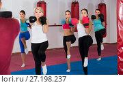 Купить «group of serious women and their trainer are boxing in gym», фото № 27198237, снято 8 октября 2017 г. (c) Яков Филимонов / Фотобанк Лори