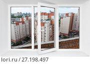 Купить «Белое пластиковое окно с видом на высотные жилые новостройки, открытая створка», фото № 27198497, снято 12 декабря 2017 г. (c) Кекяляйнен Андрей / Фотобанк Лори