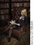 Купить «Confident business woman in the classical library», фото № 27198641, снято 18 августа 2017 г. (c) Дмитрий Черевко / Фотобанк Лори