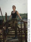 Купить «Girl with a gun in an abandoned factory», фото № 27198653, снято 20 августа 2017 г. (c) Дмитрий Черевко / Фотобанк Лори