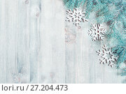 Купить «New Year and Christmas background. Christmas toys, blue fir tree on the wooden background. New Year composition. New Year and Christmas still life with free space for text», фото № 27204473, снято 8 мая 2017 г. (c) Зезелина Марина / Фотобанк Лори
