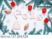 Купить «New Year 2018 background with 2018 figures,Christmas toys, fir branches. New Year 2018 festive composition», фото № 27204529, снято 30 ноября 2016 г. (c) Зезелина Марина / Фотобанк Лори