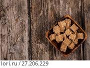 Купить «Bowl with cubes of cane sugar», фото № 27206229, снято 1 ноября 2017 г. (c) Елена Блохина / Фотобанк Лори