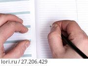 Купить «Businessman makes notes in a diary», фото № 27206429, снято 2 апреля 2015 г. (c) Евгений Ткачёв / Фотобанк Лори