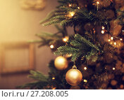 Купить «decorations on a Christmas tree and glare of lights», фото № 27208005, снято 4 ноября 2017 г. (c) katalinks / Фотобанк Лори