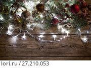 Купить «Christmas tree garland glows», фото № 27210053, снято 15 ноября 2017 г. (c) Типляшина Евгения / Фотобанк Лори