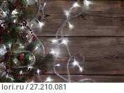 Купить «Christmas tree garland glows», фото № 27210081, снято 15 ноября 2017 г. (c) Типляшина Евгения / Фотобанк Лори