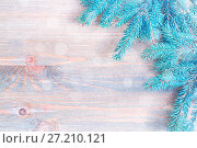 Купить «New Year and Christmas background. Blue fir tree branches with snowflakes on the wooden background. New Year and Christmas festive still life, free space for text», фото № 27210121, снято 8 мая 2017 г. (c) Зезелина Марина / Фотобанк Лори