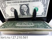 Купить «Electronic money counter machine is counting is counting the American one dollar(US dollars) banknotes», фото № 27210561, снято 17 октября 2017 г. (c) Куликов Константин / Фотобанк Лори