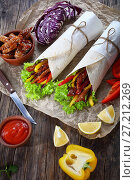 Купить «tasty flatbread shawarma wraps and ingredients», фото № 27212269, снято 5 ноября 2017 г. (c) Oksana Zh / Фотобанк Лори
