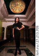 Купить «Woman in a black dress», фото № 27213709, снято 4 ноября 2017 г. (c) Art Konovalov / Фотобанк Лори