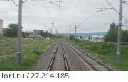 Купить «Railroad view from the window of the last railway carriage», видеоролик № 27214185, снято 17 ноября 2017 г. (c) Dzmitry Astapkovich / Фотобанк Лори