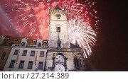 Купить «Old Town City Hall and holiday fireworks in Prague, view from Old Town Square, Czech Republic», видеоролик № 27214389, снято 18 ноября 2017 г. (c) Владимир Журавлев / Фотобанк Лори