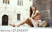 Купить «young positive girl in romantic dress sitting in town», видеоролик № 27214617, снято 8 сентября 2017 г. (c) Яков Филимонов / Фотобанк Лори