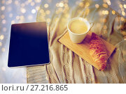 Купить «tablet pc, coffee and croissant on bed at home», фото № 27216865, снято 15 октября 2016 г. (c) Syda Productions / Фотобанк Лори
