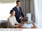 Купить «business team with papers working at hotel room», фото № 27216937, снято 22 мая 2017 г. (c) Syda Productions / Фотобанк Лори