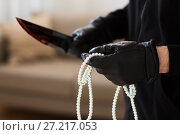 criminal with knife and jewelry at crime scene. Стоковое фото, фотограф Syda Productions / Фотобанк Лори