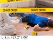 Купить «criminalist collecting evidence at crime scene», фото № 27217061, снято 5 мая 2017 г. (c) Syda Productions / Фотобанк Лори