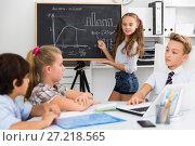 Купить «Girl discussing about mathematical formulas», фото № 27218565, снято 12 октября 2017 г. (c) Яков Филимонов / Фотобанк Лори