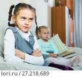 Offended girls sitting apart at home. Стоковое фото, фотограф Яков Филимонов / Фотобанк Лори