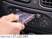 Купить «Hand inserting a music cassette into old car tape player», фото № 27220989, снято 19 ноября 2017 г. (c) Георгий Дзюра / Фотобанк Лори