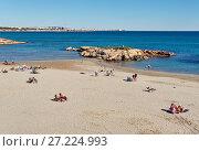 Купить «People sunbathing at the Cala Capitan beach. Spain», фото № 27224993, снято 5 ноября 2017 г. (c) Alexander Tihonovs / Фотобанк Лори