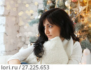 Купить «Christmas decorations, young woman in december evening», фото № 27225653, снято 9 декабря 2016 г. (c) ElenArt / Фотобанк Лори