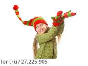 Купить «Happy baby girl striped Christmas hat and mittens catches falling snowflakes», фото № 27225905, снято 19 ноября 2017 г. (c) Юлия Кузнецова / Фотобанк Лори