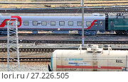 Купить «View on the railway track with train and railway depot at the Samara railway station in summer day», видеоролик № 27226505, снято 24 июня 2019 г. (c) FotograFF / Фотобанк Лори
