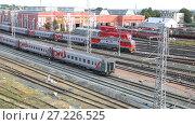 Купить «View on the railway track with train and railway depot at the Samara railway station in summer day», видеоролик № 27226525, снято 27 мая 2019 г. (c) FotograFF / Фотобанк Лори