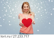 Купить «happy woman or teen girl with red heart shape», фото № 27233717, снято 30 апреля 2016 г. (c) Syda Productions / Фотобанк Лори