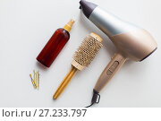 Купить «hairdryer, brush, hot styling hair spray and pins», фото № 27233797, снято 12 апреля 2017 г. (c) Syda Productions / Фотобанк Лори