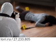 Купить «criminalist photographing dead body at crime scene», фото № 27233805, снято 5 мая 2017 г. (c) Syda Productions / Фотобанк Лори
